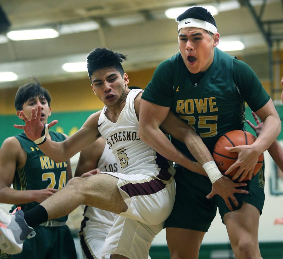 Nikki Rowe Emiliano Ramirez (35) snags a rebound in front of Los Fresnos Dayton Noriega (5) during the City of Palms championship high school basketball game at Nikki Rowe High school gymnasium on Saturday, Dec.21, 2019 in McAllen.  Photo by Delcia Lopez/The Monitor  dlopez@themonitor.com